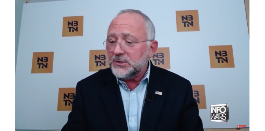 John Michael Chambers on Alex Jones Show with our Q Flag Pin on